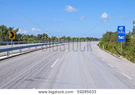 Empty Highway To Tropical Beach