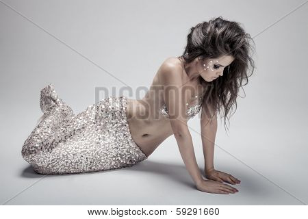 Fashion Fantasy Mermaid. Studio Shot. Gray Background.