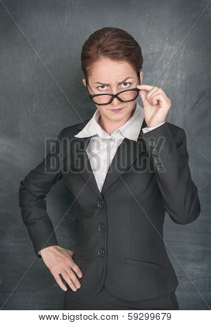 Strict Teacher Looking At Someone
