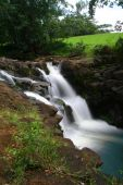 A time exposure of a small cascade, Ho Opi' I Falls, which is quite a hike into the back country of Kauai, Hawaii. poster