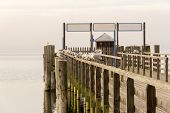 Wooden Dock with Birds by the Fishing Quiet Lake During Winter Season poster
