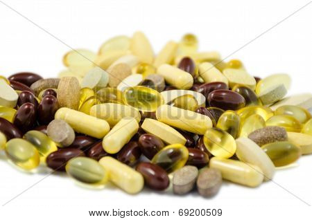 Fish Oil And Brown Capsule ,green Tea Extract , Tablets Food Supplements Tablets On White Bacground