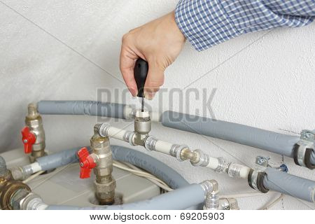 Technician is Fixing Central Heating System