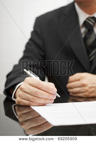 Businessman Thinking About A Deal To Sign