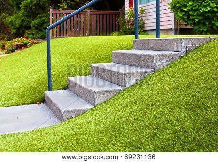 Perfect grass landscaping with artificial grass in residential area