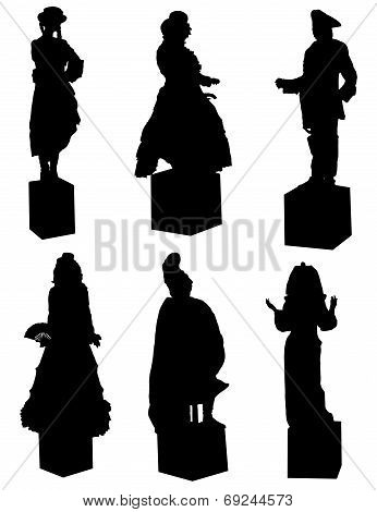 Collection of silhouettes of live statues on a white background.