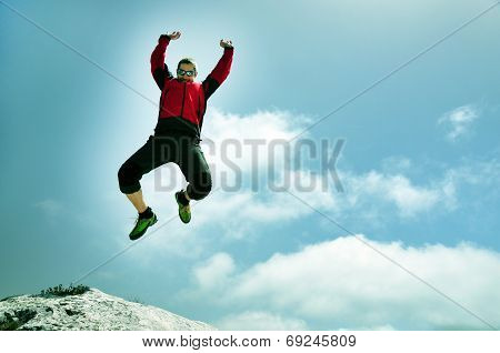 Man Jumping From A Cliff