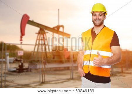 Refinery Worker Standing In Front Of The Oil Pump