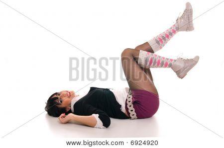 Happy school girl lying on the floor