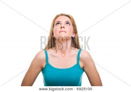 Beautiful blonde girl looking up