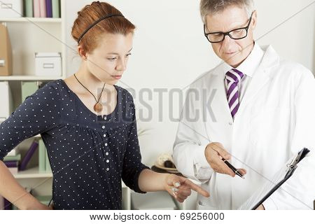 Doctor With Young Female Patient Woman
