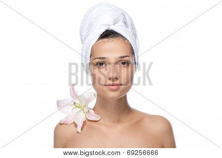 Young woman with white flower and towel