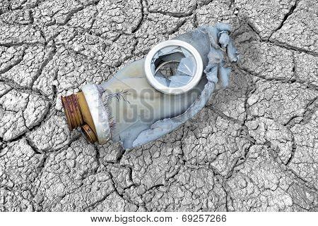 Dirty Broken Gas Mask On Cracks