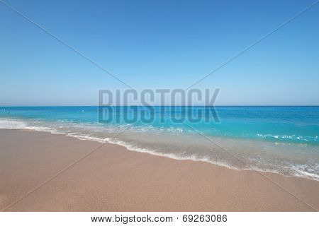 Sandy long beach with turquoise waters