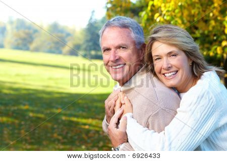 Happy elderly seniors couple in park. Golden age. poster