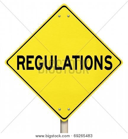 Regulations word on a yellow warning or danger road sign illustrating the perils of not following rules, laws and guidelines