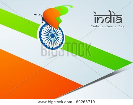 Beautiful butterfly in saffron and green colors with Asoka Wheel on national flag background for Indian Independence Day celebrations.
