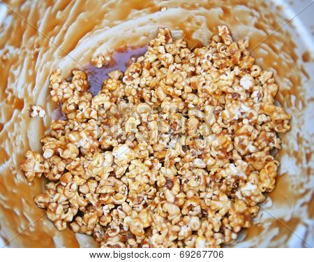 a bowl of caramel corn that is almost empty