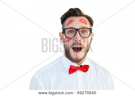 Geeky hipster with kisses on his face on white background