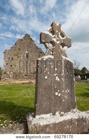 Celtic gravestone and church ruins