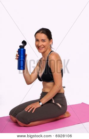 A photo of a girl with bottle of water.