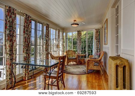 Bright Sunroom With Wicker Furniture