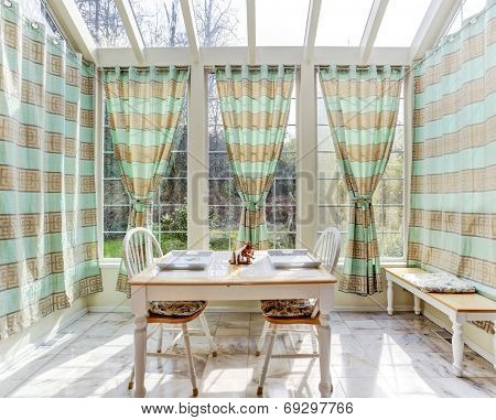 Bright Sun Room With Dining Table Set