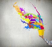 Close up of hand splashing colorful paint from colorful bucket poster