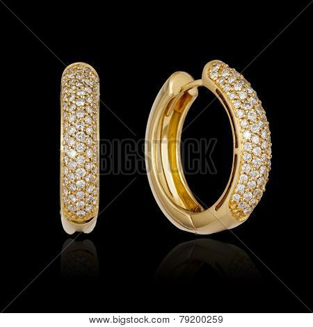 Gold Diamond Earrings Isolated On Black Background