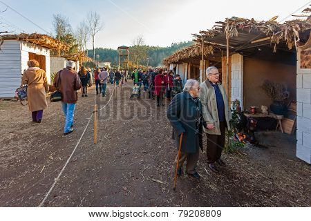 Priscos, Portugal. December 26, 2014: Visitors enjoying the historical stalls reenactments. Built by the population, the live Nativity Scene and biblical village reenactment is the largest in Europe.