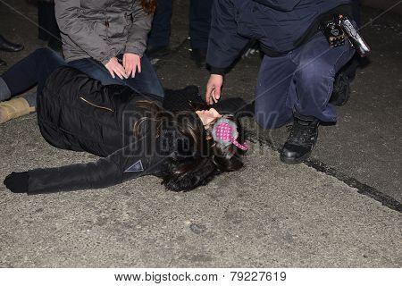 Unconscious reveler being treated
