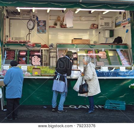 Shoppers being served at a meat stall