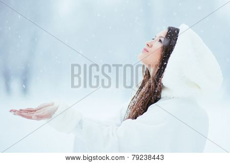 Girl Collecting Snowflakes