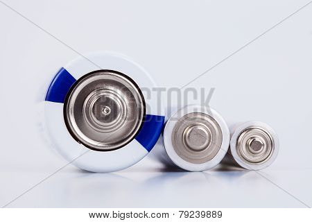 Raw of yellow AA alkaline batteries isolated on white background poster
