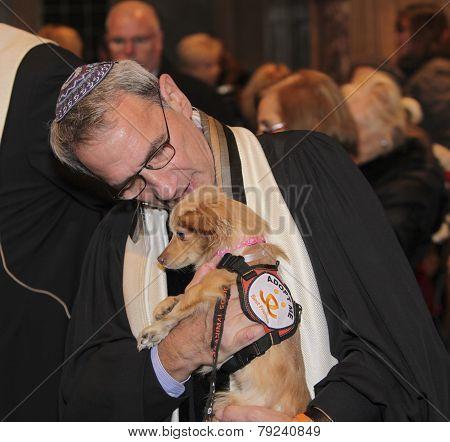 Rabbi Rubinstein with rescue dog
