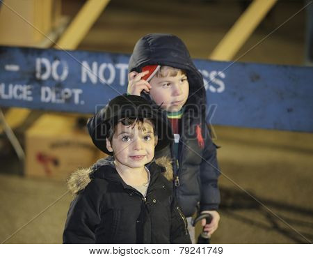 Kids playing by police barrier