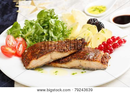 Dish of a delicious roasted salmon fillet with crust