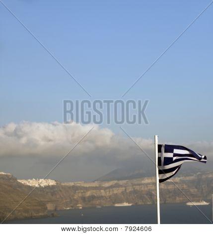 Flag Of Greece Flying Over The Caldera Oia Santorini