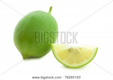 Fresh green limes isolated on white background .