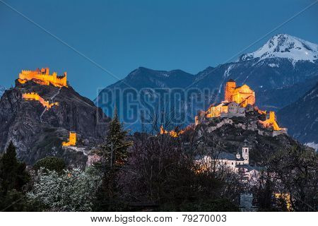 Switzerland, Valais, Sion, Night Shot of the  two Castles - Tourbillon castle on the left and the fortified basilica of Valere is on the hill to the right