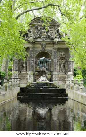 the Medicii Fountain La fontaine Medicis in Luxembourg Gardens Paris France with sculptures of the giant Polyphemus surprising the lovers Acis and Galatea poster