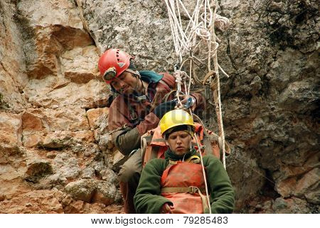 Cavers work out rescue operations in caves.