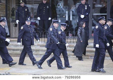 84th Precinct members file by