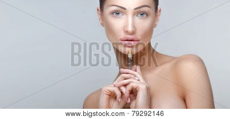Beauty portrait of attractive woman giving botox injections. poster