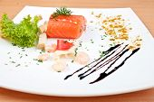 delicious salmon on plate decorated with salad cheese and seafood poster