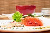 delicious salmon on plate with soy sauce seafood and spice poster