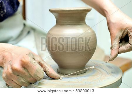 The creation of pottery. Hand painted. Handmade with clay.