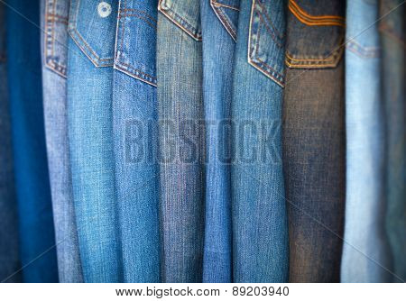 Blue-jeans In Various Shades Of Blue, Arranged On Display.