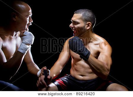 Trainer motivating a muscular Boxer or MMA fighter with pep talks poster
