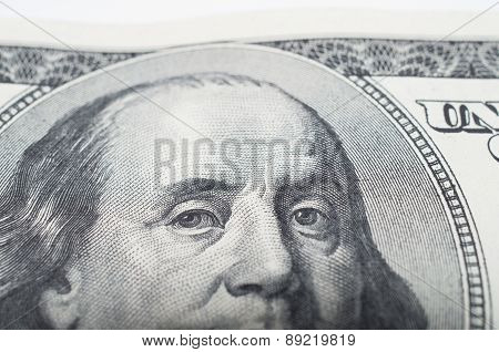 Macro close up of Benjamin Franklin's face on the US bank note eye selective focus